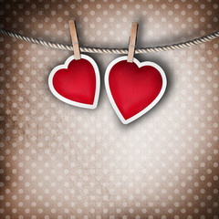 Valentine background: two hearts hanging on clothespin. Couple c