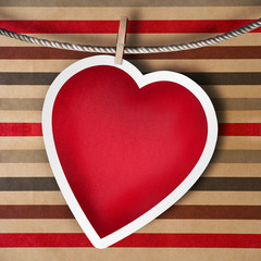 Valentine background: heart hanging on clothespin