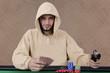 Poker player pointing gun