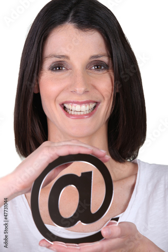 a woman showing an @