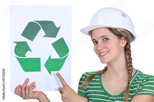 Craftswoman displaying recycling sign