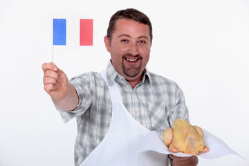 Frenchman proudly waving the flag over his uncooked chicken