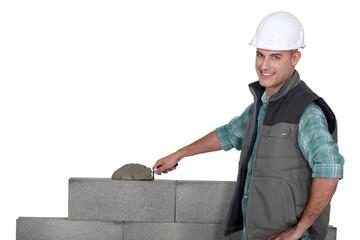Bricklayer building a block wall