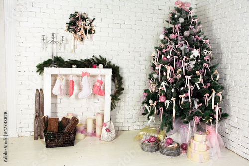 Nice Christmas interior with a fir-tree, fireplace and gifts