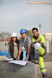 Three construction workers sharing their ideas