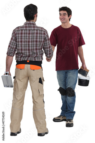 Construction workers greeting