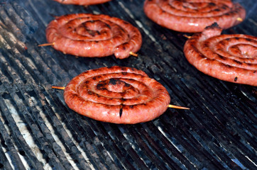 spiral sausages on the grill