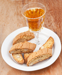 wineglass and italian almond cantuccini on table