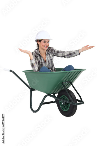Woman sat in wheelbarrow