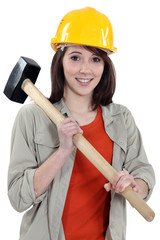 Female labouror holding  hammer