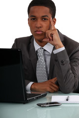 businessman at his desk thinking
