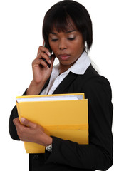 Businesswoman making important call