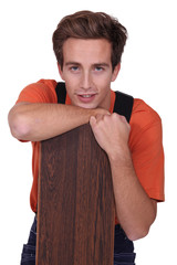 Young man with wooden floor boards