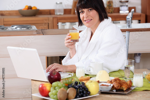 Woman having breakfast in the kitchen
