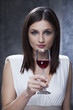 woman celebrating birthday with red wine