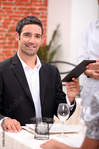 businessman eating in a restaurant