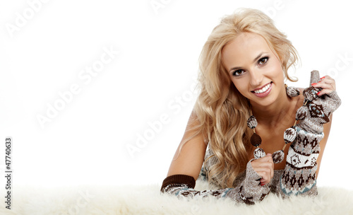 Beautiful Winter woman on white fur