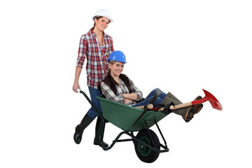 Two women with wheelbarrow