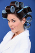 woman in bath robe and curlers in her hair