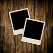 Blank instant photo frames on old wooden background