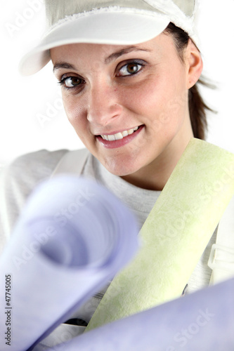 Female decorator holding selection of wall paper