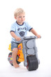 Young boy on a toy bike