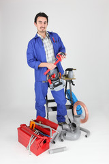 portrait of plumber with tools