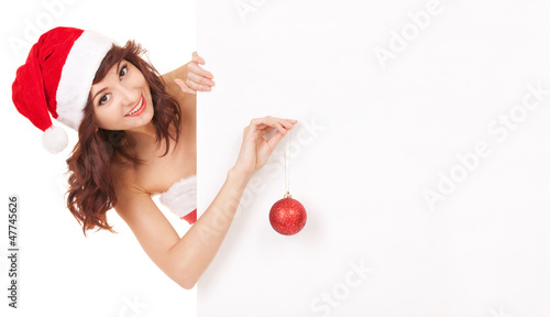 Santa woman decorating a white blank board