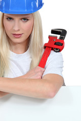 Woman with an adjustable spanner