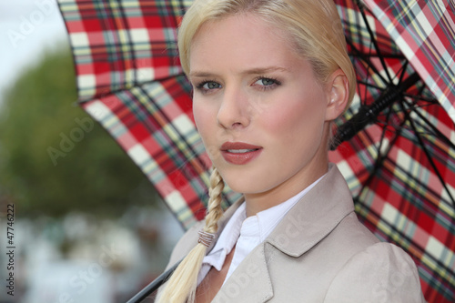 Snobby woman holding an umbrella