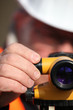 Civil engineer adjusting a theodolite