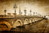Fototapeta Bordeaux river bridge with St Michel cathedral