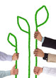 Hands holding rope forming green plants with leaves
