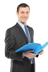 A smiling businessman holding a document