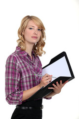 Woman writing in an office planner