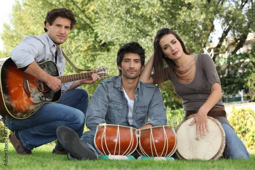 three musicians in a park