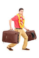 Guy carrying very heavy travel bags and gesturing