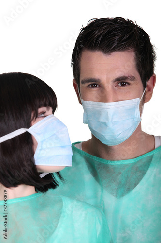 Surgeons wearing face masks