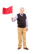 Full length portrait of a sad senior man waving a red flag