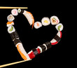 Sushi sticks holding pieces of sushi in heart shape