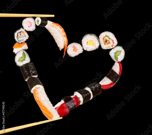 Sushi sticks holding pieces of sushi in heart shape - 47749245
