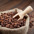 sack with coffee beans and wooden scoop