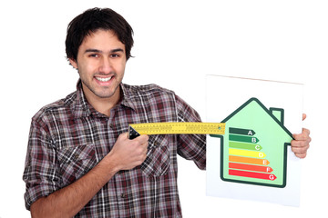 Man with an energy rating sign