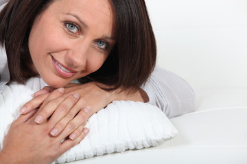 Woman laying on pillow