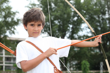 Boy with a bow and arrow