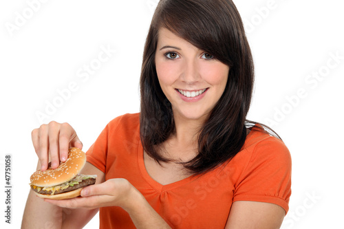 girl looking at a hamburger