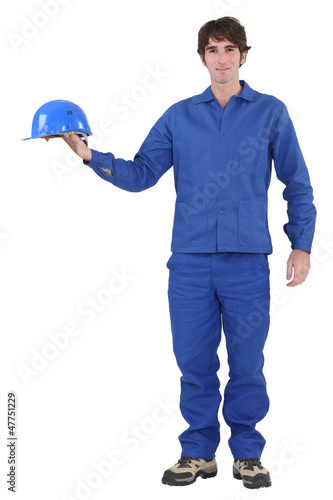 craftsman holding his helmet