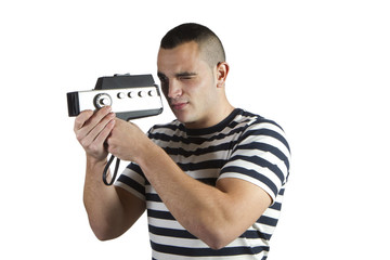 young man recording with old movie camera domestic