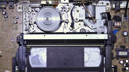 VHS tape inserted into VCR inside vision