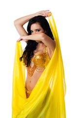 Belly dancer posing with a bright yellow silk veil